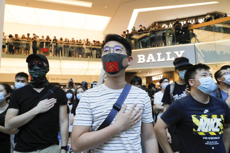 "Anti-government protesters as people sing during a rally inside a shopping mall at Sha Tin district in Hong Kong Sunday, Sept. 22, 2019. Young protesters, many wearing masks to disguise their identity, filled the open area of a Hong Kong shopping mall Sunday and folded paper ""origami"" cranes in the latest twist in a pro-democracy movement that has stretched into a fourth month. (AP Photo/Kin Cheung)"