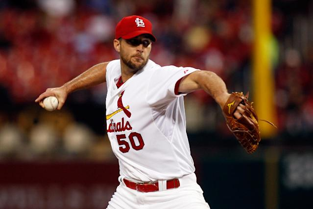 St. Louis Cardinals starting pitcher Adam Wainwright throws during the first inning of a baseball game against the Chicago Cubs on Tuesday, May 13, 2014, in St. Louis. (AP Photo/Scott Kane)