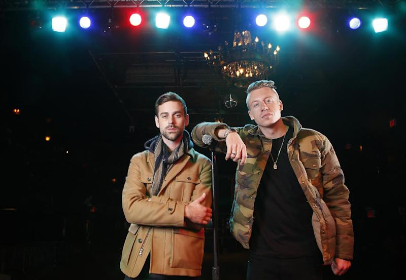 """FILE - In this Nov. 20, 2012 file photo, American musician Ben Haggerty, better known by his stage name Macklemore, right, and his producer Ryan Lewis pose for a portrait at Irving Plaza in New York. Macklemore & Ryan Lewis are top contenders at the Grammy Awards on Sunday, Jan. 26, 2014, with seven nominations, including best new artist and song of the year for """"Same Love."""" Their debut album, """"The Heist,"""" is up for album of the year and best rap album, while the massive hit """"Thrift Shop"""" is nominated for best rap song and rap performance. The duo's other hit, """"Can't Hold Us,"""" will compete for best music video. (Photo by Carlo Allegri/Invision/AP, File)"""