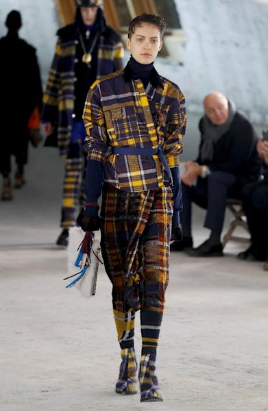 Sacai gave their take on tartan, a dominant winter theme which made an appearance in a slew of collections (AFP Photo/FRANCOIS GUILLOT)