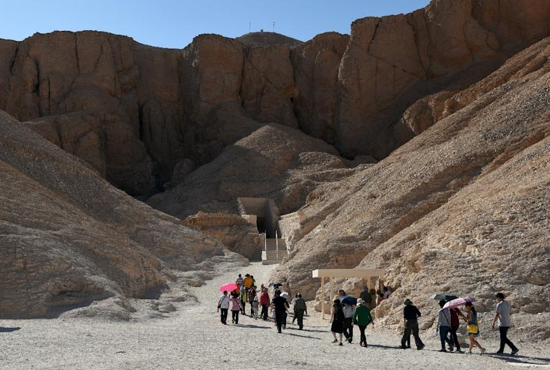 Tourists walk outside King Tutankhamun's tomb at the Valley of the Kings, near Egypt's southern city of Luxor on March 31, 2016