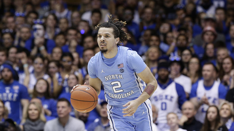 North Carolina guard Cole Anthony (2) dribbles against Duke during the first half of an NCAA college basketball game in Durham, N.C., Saturday, March 7, 2020. (AP Photo/Gerry Broome)