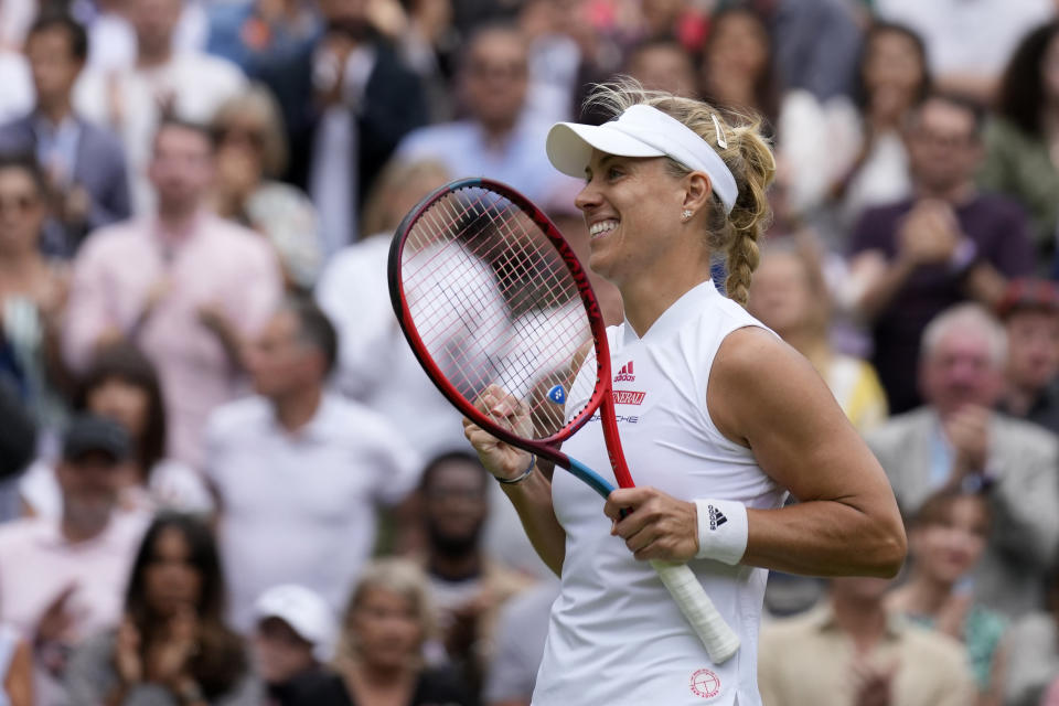 Germany's Angelique Kerber celebrates after defeating Coco Gauff of the U.S. during the women's singles fourth round match on day seven of the Wimbledon Tennis Championships in London, Monday, July 5, 2021. (AP Photo/Kirsty Wigglesworth)