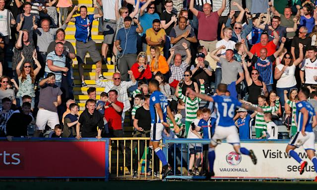 Rochdale fans celebrate after Joe Thompson, who returned to playing after cancer treatment in February, scores the winning goal.