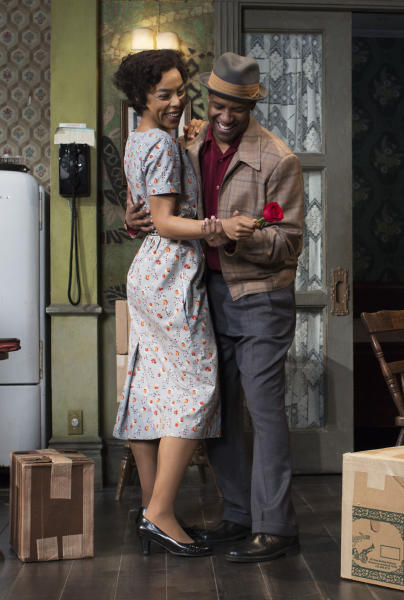"""This image released by Philip Rinaldi Publicity shows Sophie Okonedo, left, and Denzel Washington during a performance of """"A Raisin in the Sun,"""" at the Ethel Barrymore Theatre in New York. (AP Photo/Philip Rinaldi Publicity, Brigitte Lacombe)"""