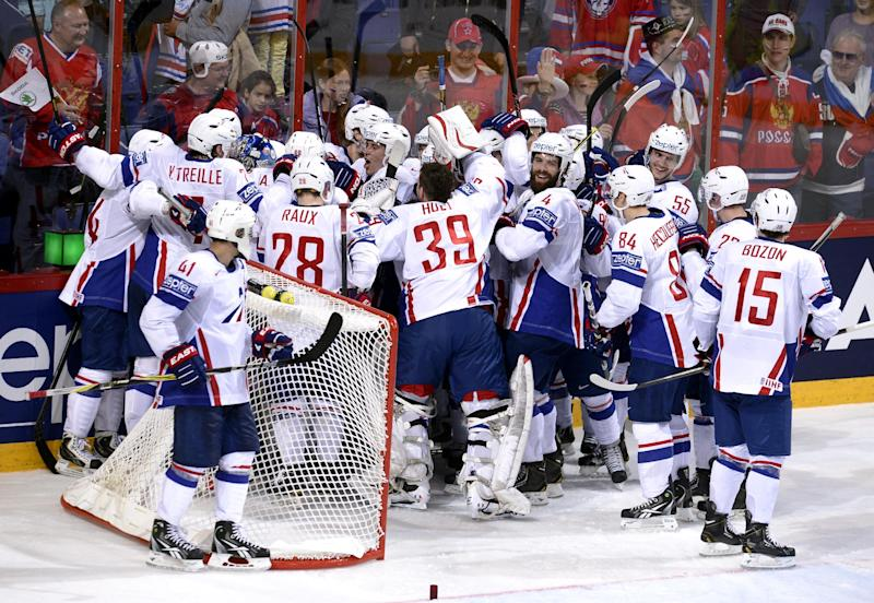 Team France players celebrate after the match as they surprised Russia by winning 2-1 during the 2013 Ice Hockey World Championships preliminary round match Russia vs France in Helsinki, Finland on Thursday, May 9, 2013. (AP Photo/LEHTIKUVA / Heikki Saukkomaa) FINLAND OUT