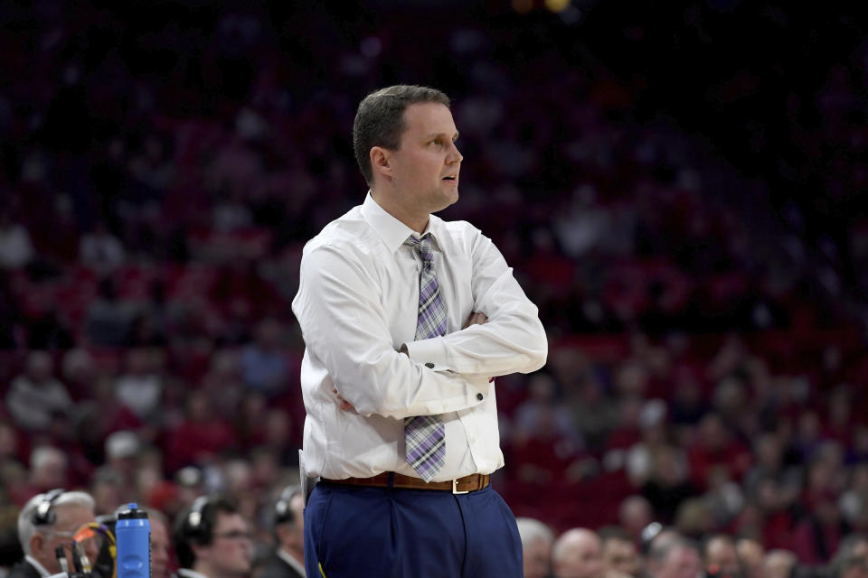 LSU coach Will Wade on the sidelines against Arkansas during an NCAA college basketball game Wednesday, March 4, 2020, in Fayetteville, Ark. (AP Photo/Michael Woods)