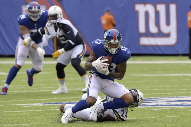 New York Giants wide receiver Odell Beckham (13) catches a pass in front of Los Angeles Chargers cornerback Trevor Williams (24) during the first half of an NFL football game, Sunday, Oct. 8, 2017, in East Rutherford, N.J. (AP Photo/Bill Kostroun)