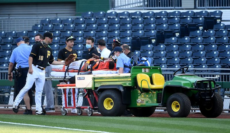 Pirates infielder Phillip Evans was stretchered off the field Saturday after a collision with teammate Gregory Polanco. (Photo by Justin Berl/Getty Images)