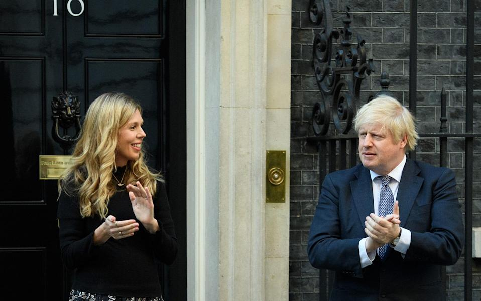Mr Johnson with his finacee, who is said to have masterminded a refurbishment of the No11 Downing Street flat - Getty Images Europe/Leon Neal