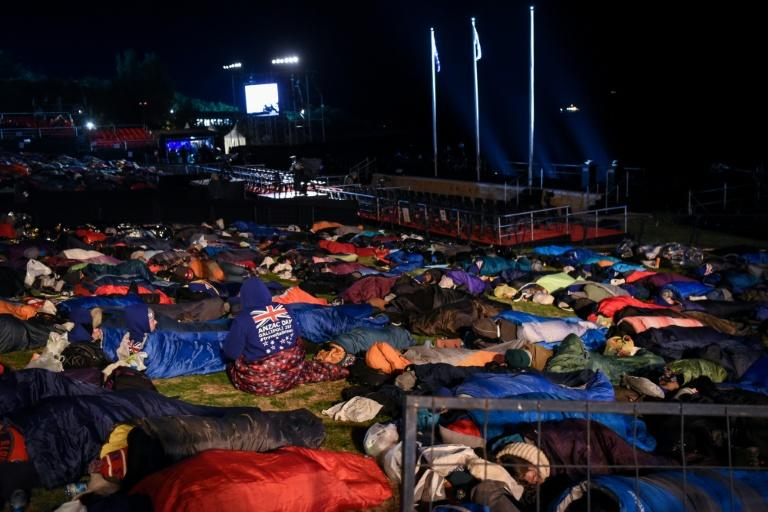 People sleep out before a dawn service marking Anzac Day in Gallipoli on April 25, 2017