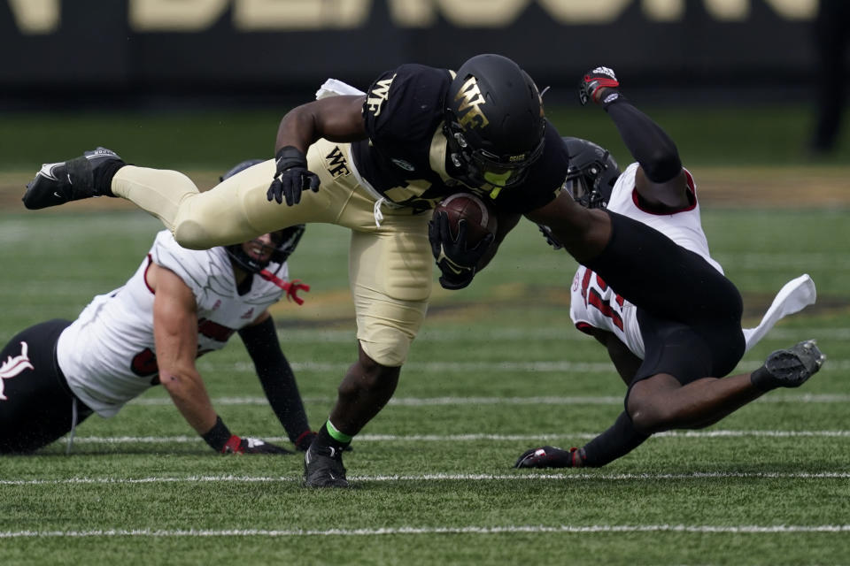 Wake Forest running back Justice Ellison runs against Louisville during the first half of an NCAA college football game on Saturday, Oct. 2, 2021, in Winston-Salem, N.C. (AP Photo/Chris Carlson)