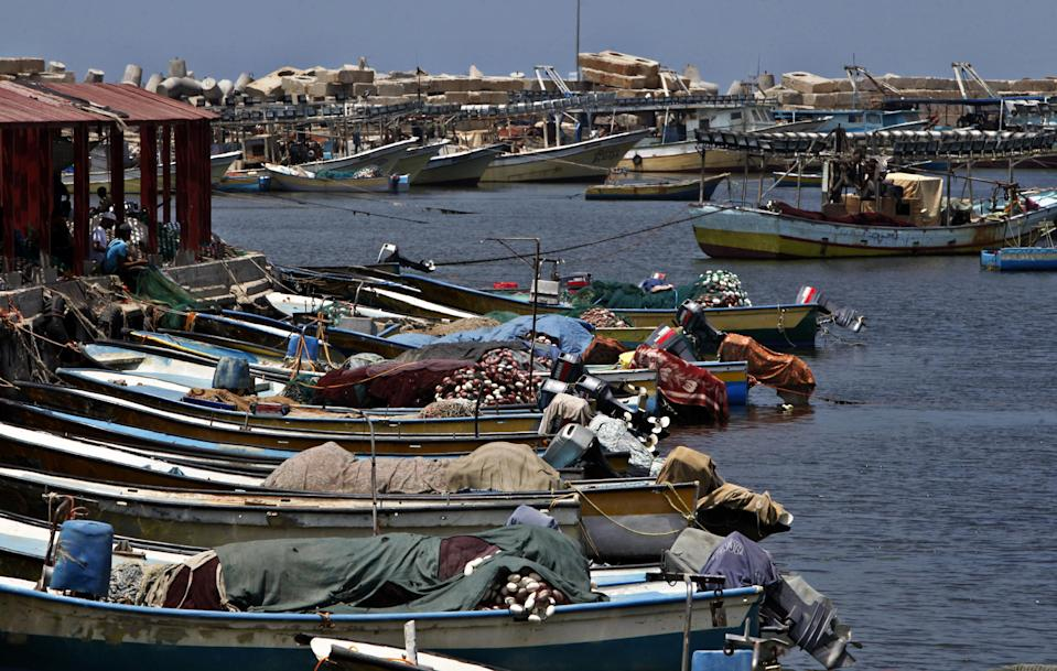 In this photo taken on Wednesday, July 31, 2013, Palestinian boats wait to sail as they refuel at the fishermen sea port in Gaza City. Regime change in Egypt has cost the Hamas rulers of Gaza their most important foreign ally, and ordinary Palestinians are being caught up in the animosity. Many Gazans were laid off after Egypt closed the territory's border, and Palestinians living in Egypt are keeping a low profile for fear of being targeted in the backlash against Hamas. (AP Photo/Adel Hana)