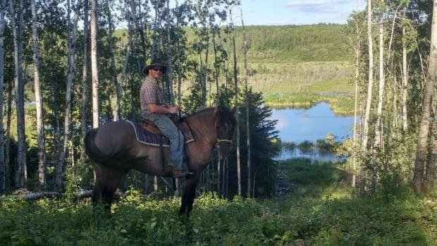 John Prosak on the trail from Sturgeon River Ranch into Prince Albert National Park.  (Sturgeon River Ranch  - image credit)