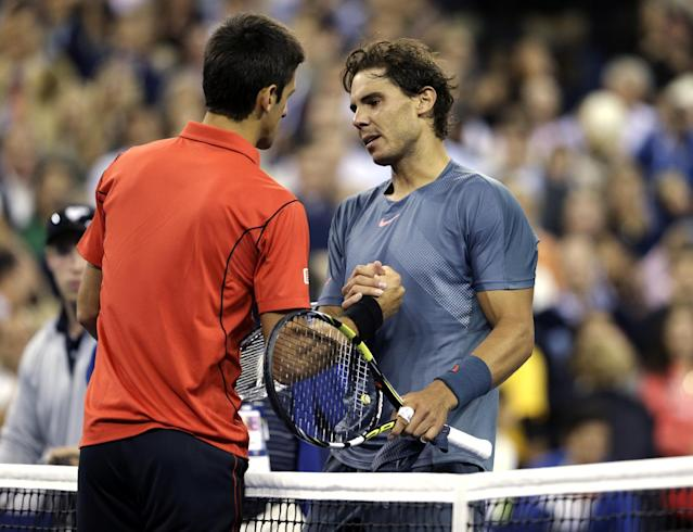 Rafael Nadal, of Spain, greets Novak Djokovic, of Serbia, at the net after winning the men's singles final of the 2013 U.S. Open tennis tournament, Monday, Sept. 9, 2013, in New York. (AP Photo/Darron Cummings)