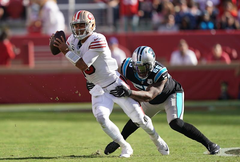 SANTA CLARA, CALIFORNIA - OCTOBER 27: Bruce Irvin #55 of the Carolina Panthers sacks quarterback Jimmy Garoppolo #10 of the San Francisco 49ers during the third quarter of an NFL football game at Levi's Stadium on October 27, 2019 in Santa Clara, California. (Photo by Thearon W. Henderson/Getty Images)