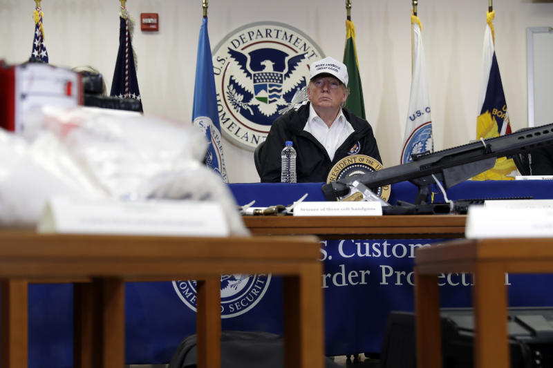 With illegal drugs and weapons displayed in the foreground, President Donald Trump speaks at a roundtable on immigration and border security at U.S. Border Patrol McAllen Station, during a visit to the southern border, Thursday, Jan. 10, 2019, in McAllen, Texas. (AP Photo/ Evan Vucci)