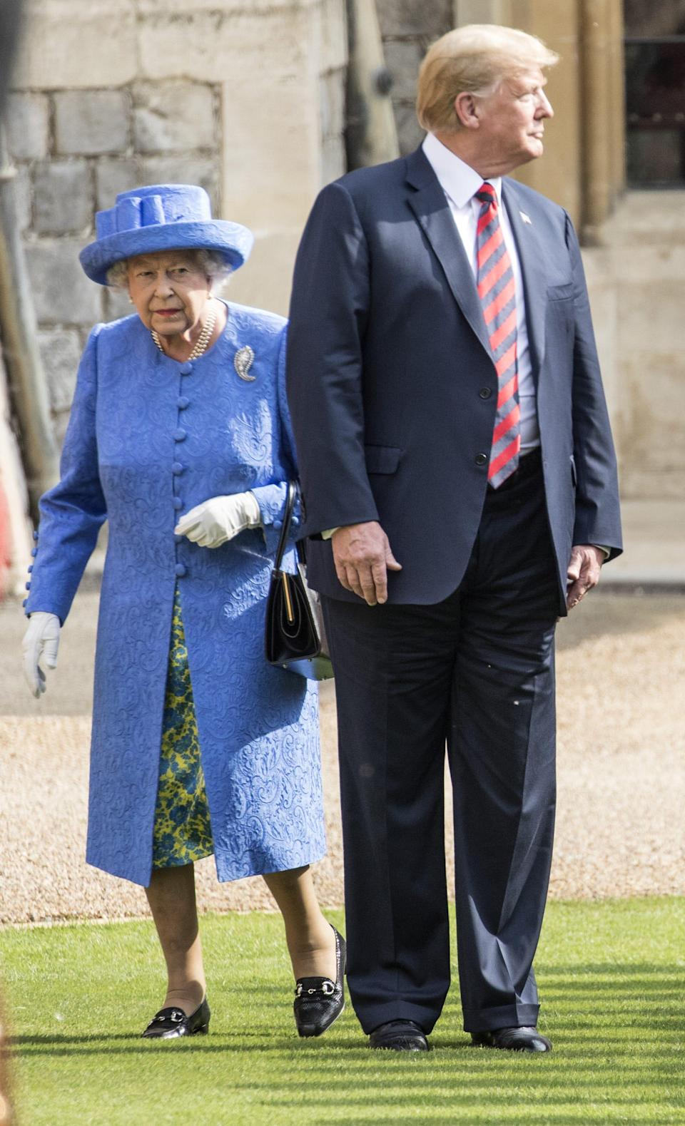 President Donald Trump and Queen Elizabeth II inspect a Guard of Honour on the Quadrangle at Windsor Castle after which he and first lady Melania Trump joined Her Majesty for tea at the castle, on July 13, 2018.