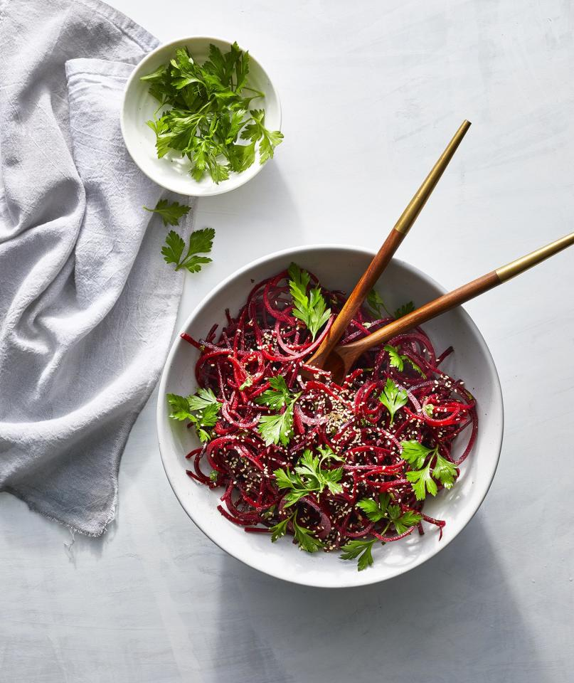 """<p>This Asian-inspired side dish is crunchy and sweet, and might just be our new favorite way to eat beets. If you can't find spiralized beet noodles (available at Fresh Market and Whole Foods, among other grocery stores), shredded beets would be just as nice. Or, opt for carrot noodles.</p> <p> <strong>Get the Recipe:</strong> <a href=""""https://www.realsimple.com/food-recipes/browse-all-recipes/spiralized-sesame-beet-salad"""" target=""""_blank"""">Spiralized Sesame Beet Salad</a></p>"""