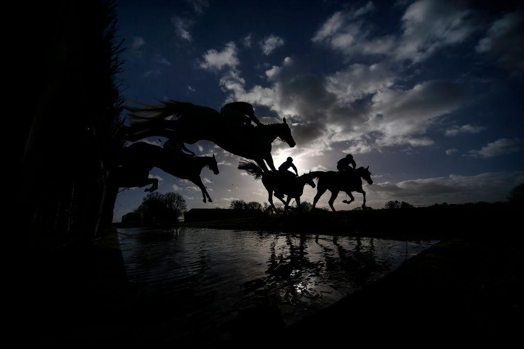 <p>Runners clear the water jump at Wincanton racecourse in Wincanton, United Kingdom. (Alan Crowhurst/Getty Images) </p>