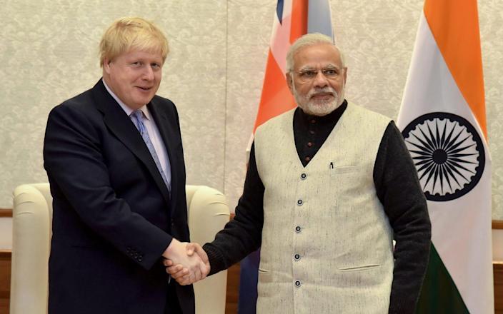 Boris Johnson shakes hands with Indian prime minister Narendra Modiv in New Delhi, 2017 - AFP via Getty Images