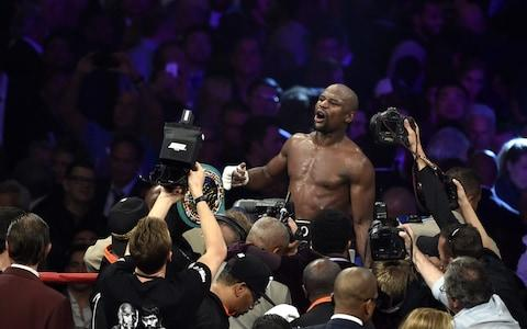 Floyd Mayweather Jr., reacts after defeating Manny Paciquiao during their welterweight unification bout at MGM Grand Garden Arena Saturday, May 2, 2015 - Credit: Barcroft Media