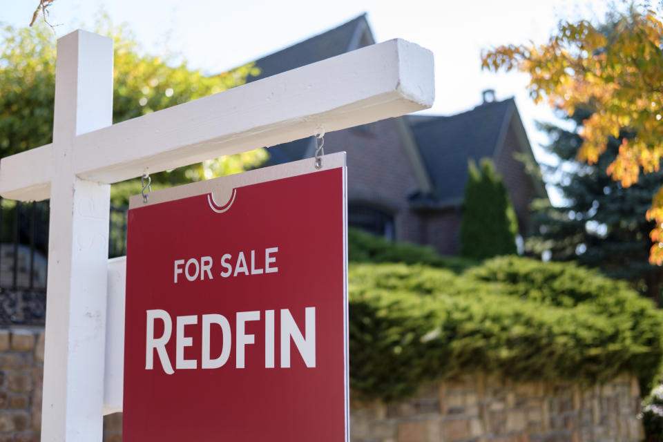 SEATTLE, WA - OCTOBER 31: A Redfin real estate yard sign is pictured in front of a house on October 31, 2017 in Seattle, Washington. Seattle has been one of the fastest and most competitive housing markets in the United States throughout 2017. (Photo by Stephen Brashear/Getty Images for Redfin)