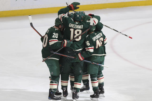 Minnesota Wild's Jordan Greenway (18) celebrates with teammates fter scoring a goal against the Winnipeg Jets in the first period of an NHL hockey game Thursday, Jan. 10, 2019, in St. Paul, Minn. (AP Photo/Stacy Bengs)
