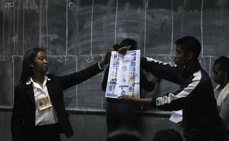 Electoral officials count cast votes at a polling centre in the capital Antananarivo