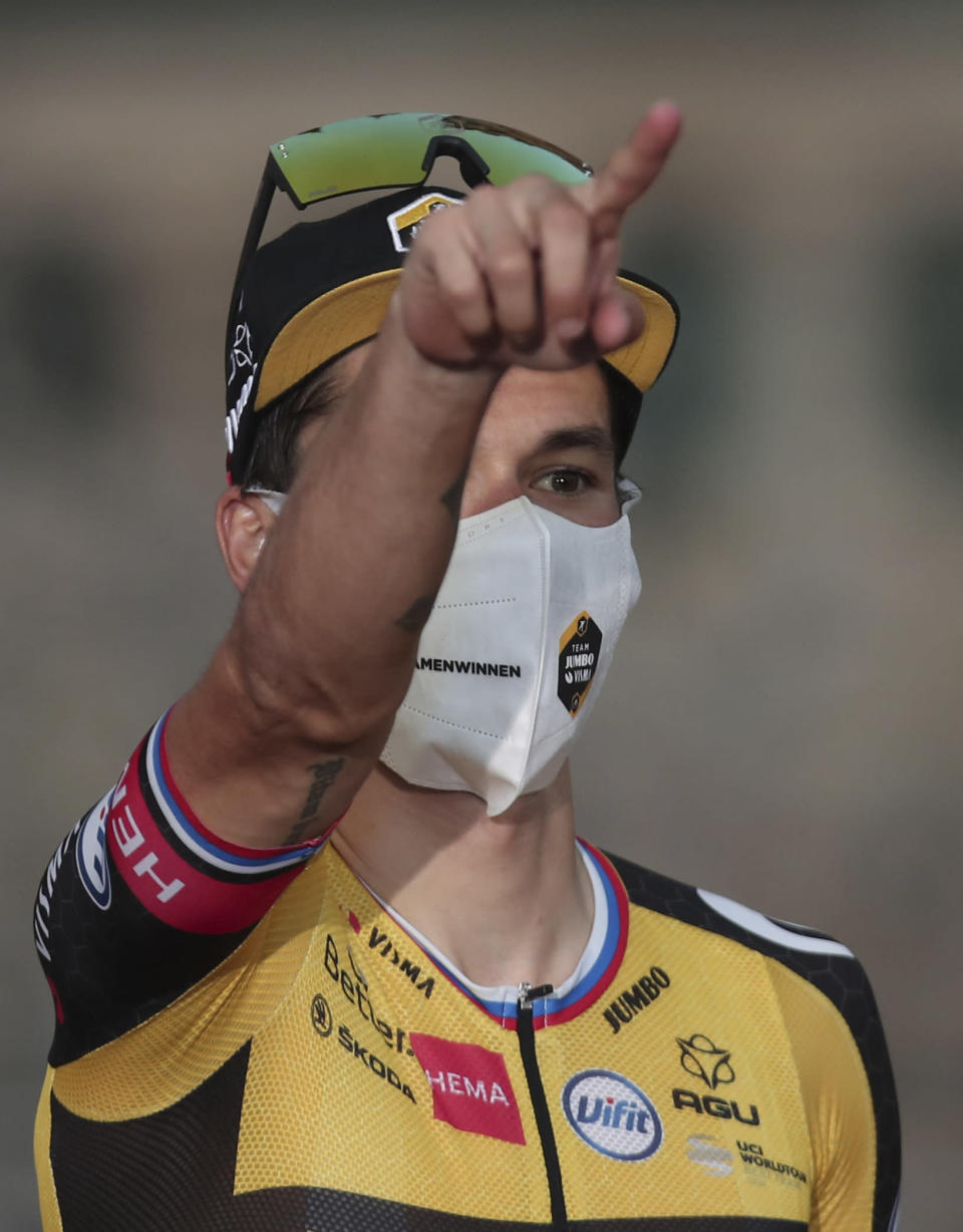 Primoz Roglic celebrates on the podium after winning the Vuelta Cycling race in Santiago, Spain, Sunday, Sept. 5, 2021. (AP Photo/Luis Vieira)