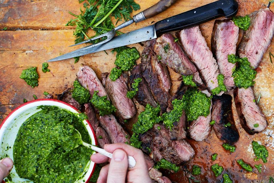 """Grill tender, inexpensive chuck eye steaks and top with a salsa verde made with carrot tops instead of parsley—it's gorgeous on pretty much anything! <a href=""""https://www.epicurious.com/recipes/food/views/chuck-eye-with-carrot-top-salsa-verde?mbid=synd_yahoo_rss"""" rel=""""nofollow noopener"""" target=""""_blank"""" data-ylk=""""slk:See recipe."""" class=""""link rapid-noclick-resp"""">See recipe.</a>"""