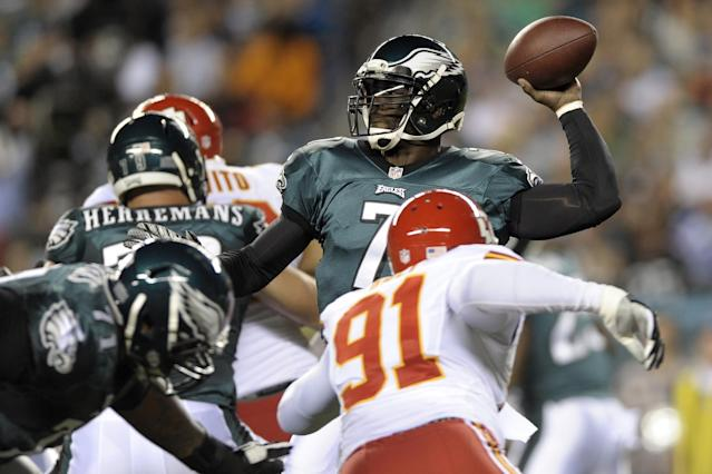 Philadelphia Eagles quarterback Michael Vick passes during the first half of an NFL football game against the Kansas City Chiefs, Thursday, Sept. 19, 2013, in Philadelphia. (AP Photo/Michael Perez)