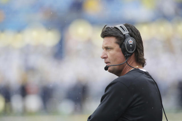 Tennessee is reportedly pursuingOklahoma State head coach Mike Gundy. (AP Photo/Raymond Thompson)