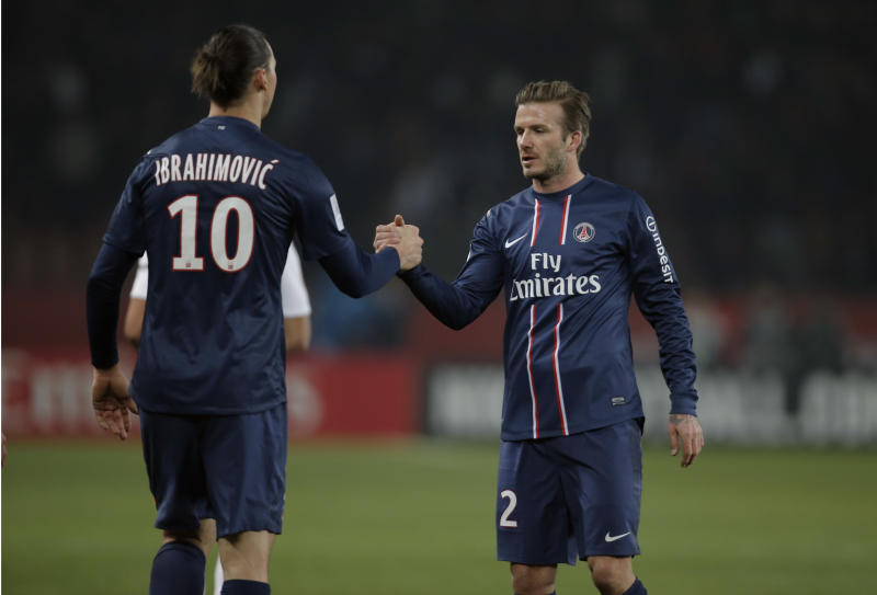 Paris Saint Germain's Zlatan Ibrahimovic from Sweden shakes hands with David Beckham after their League One soccer match between PSG and Montpellier at Parc des Princes Stadium, in Paris, Friday March 29, 2013. (AP Photo/Francois Mori)