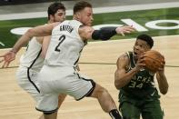 Milwaukee Bucks' Giannis Antetokounmpo shoots past Brooklyn Nets' Blake Griffin during the second half of an NBA basketball game Sunday, May 2, 2021, in Milwaukee. (AP Photo/Morry Gash)