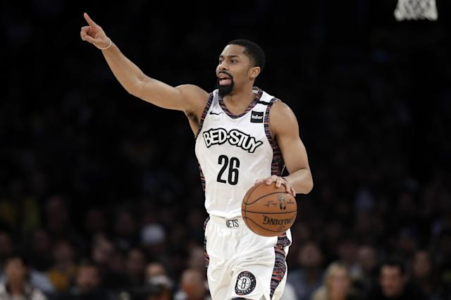 Brooklyn Nets' Spencer Dinwiddie (26) dribbles against the Los Angeles Lakers during the second half of an NBA basketball game Tuesday, March 10, 2020, in Los Angeles. (AP Photo/Marcio Jose Sanchez)