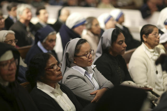 Faithful listen to Pope Francis during a meeting with Catholic priests and other Christian representatives in the cathedral of the capital, Rabat, Morocco, Sunday, March 31, 2019. Pope Francis is in Morocco for a two-day trip aimed at highlighting the North African nation's Christian-Muslim ties, while also showing solidarity with migrants at Europe's door and tending to a tiny Catholic flock. (AP Photo/Mosa'ab Elshamy)