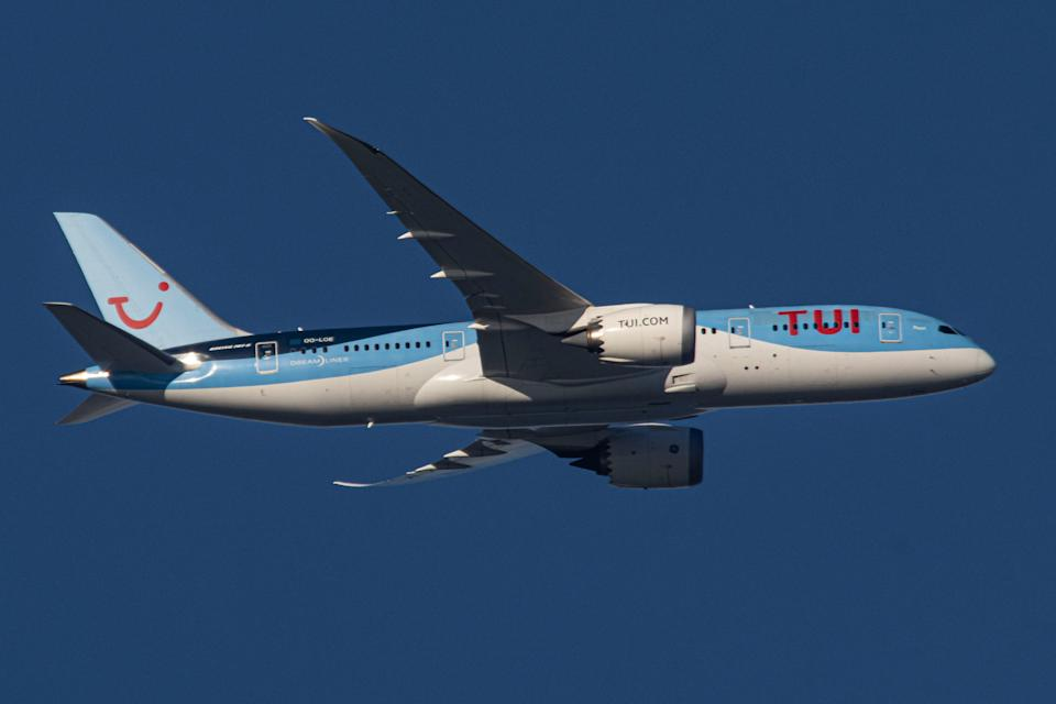 TUI Airlines Belgium Boeing 787 Dreamliner aircraft as seen flying in the blue sky on final approach to Amsterdam Schiphol International Airport AMS EHAM. The modern and advanced B787 wide-body airplane has the registration OO-LOE, the name Pearl and is powered by 2x GE jet engines. TUI Group is a multinational travel and tourism company, a holidaymaker operating also charter and scheduled flights. The specific plane belongs to TUI fly Belgium, former Jetairfly. The world passenger traffic declined during the coronavirus covid-19 pandemic era with the industry struggling to survive while passengers keep obligatory safety measures during the flights such as facemask. Amsterdam, Netherlands on December 5, 2020 (Photo by Nicolas Economou/NurPhoto via Getty Images)