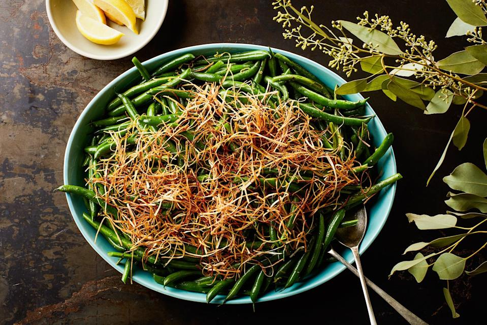 "Remember green bean casserole? This lighter spin on the classic skips the canned, condensed soup, and amps things up with fresh leeks fried in olive oil till they're toasty and crunchy. <a href=""https://www.epicurious.com/recipes/food/views/3-ingredient-lemony-green-beans-with-frizzled-leeks?mbid=synd_yahoo_rss"" rel=""nofollow noopener"" target=""_blank"" data-ylk=""slk:See recipe."" class=""link rapid-noclick-resp"">See recipe.</a>"
