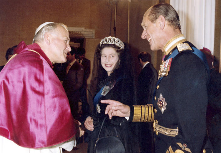 FILE - In this Oct. 17, 1980 file photo, Britain's Queen Elizabeth II, smiles at her husband Prince Philip, during an audience with Pope John Paul II in his private study at the Vatican, Italy. Buckingham Palace officials say Prince Philip, the husband of Queen Elizabeth II, has died, it was announced on Friday, April 9, 2021. He was 99. Philip spent a month in hospital earlier this year before being released on March 16 to return to Windsor Castle. Philip, also known as the Duke of Edinburgh, married Elizabeth in 1947 and was the longest-serving consort in British history. (AP Photo/Arturo Mari, File)