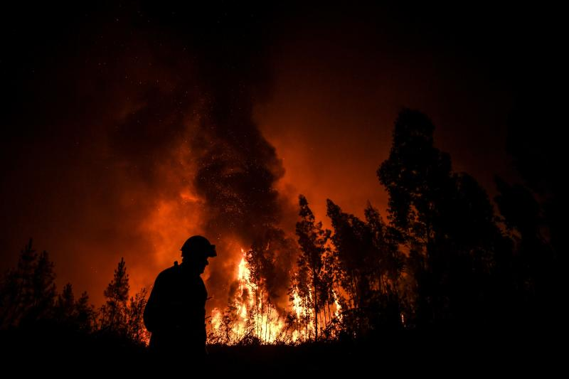 A firefighter passes while a wildfire burns the forest at Amendoa in Macao, central Portugal on July 21, 2019. (Photo: Patricia De Melo Moreira/AFP/Getty Images)