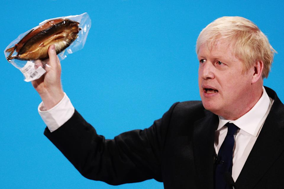 LONDON, ENGLAND - JULY 17: Boris Johnson holds a kipper (smoked fish) to help illustrate a point as he talks at the final hustings of the Conservative leadership campaign at ExCeL London on July 17, 2019 in London, England. Boris Johnson and Jeremy Hunt are the remaining candidates in contention for the Conservative Party Leadership and thus Prime Minister of the UK. Results will be announced on July 23rd 2019. (Photo by Dan Kitwood/Getty Images)