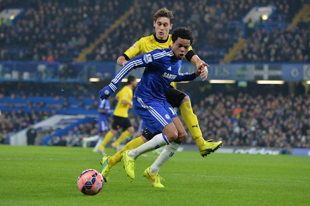 Watford's Gabriele Angella (L) and Chelsea's Loic Remy during their FA Cup third round match in London on January 4, 2015 (AFP Photo/Glyn Kirk)