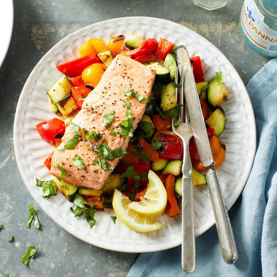 <p>Grilled salmon and veggies make for a colorful and balanced seafood dinner that's ready in just minutes. The grill turns the salmon flaky and moist while tenderizing the crispy pepper and onion pieces. Round out the meal with brown rice or quinoa.</p>