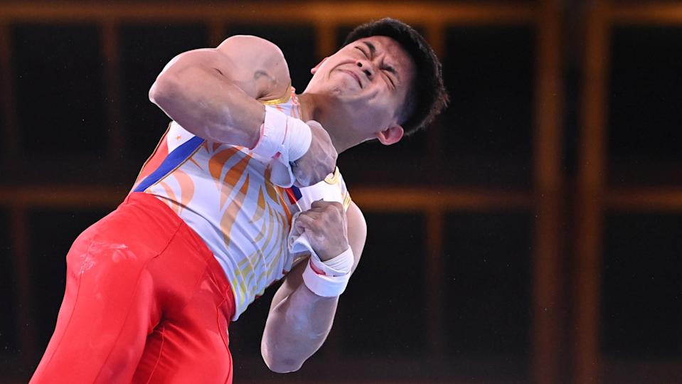 Tokyo 2020 Olympics - Gymnastics - Artistic - Men's Rings - Qualification - Ariake Gymnastics Centre, Tokyo, Japan - July 24, 2021. Carlos Edriel Yulo of the Philippines in action on the rings. REUTERS/Dylan Martinez