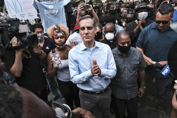FILE - In this June 2, 2020, file photo, Los Angeles Mayor Eric Garcetti arrives to appeal to Black Lives Matter protesters in downtown Los Angeles. When Garcetti withdrew his support from District Attorney Jackie Lacey this week and endorsed her opponent, it was another blow to a campaign that has been reshaped after a summer of nationwide protests over police brutality. (AP Photo/Richard Vogel,File)