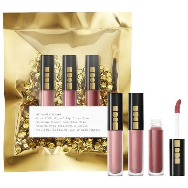 """<p>Between the gold packaging and the sequins, there are <em>also</em> three bestselling glosses in the <product href=""""https://www.sephora.com/product/mini-lust-gloss-tm-trio-P440661"""" target=""""_blank"""" class=""""ga-track"""" data-ga-category=""""internal click"""" data-ga-label=""""https://www.sephora.com/product/mini-lust-gloss-tm-trio-P440661"""" data-ga-action=""""body text link"""">Pat McGrath Labs Mini LUST: Lip Gloss Trio</product> ($25) - and this gift doesn't even need to be wrapped.</p>"""