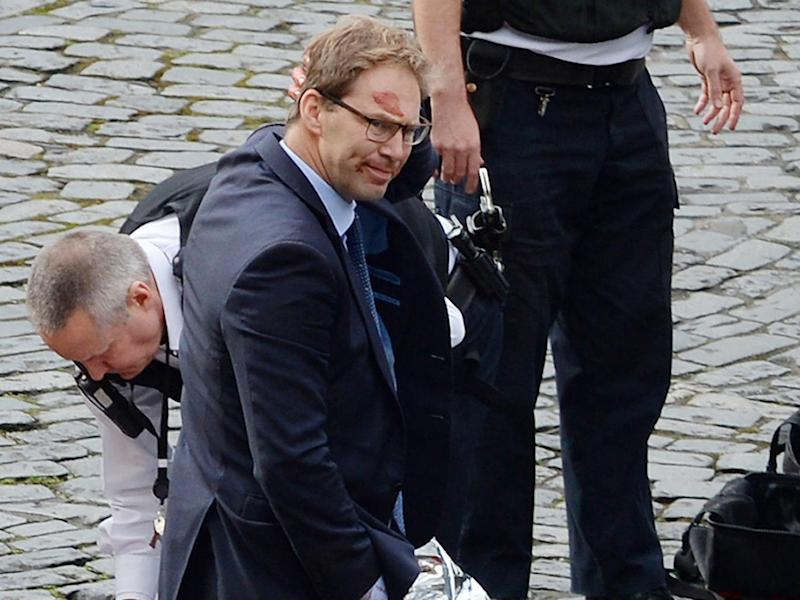 Conservative MP Tobias Ellwood stands amongst the emergency services at the scene outside the Palace of Westminster, London, after policeman has been stabbed and his apparent attacker shot by officers in a major security incident at the Houses of Parliament (PA wire)