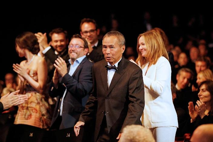 Taiwanese director Hou Hsiao-Hsien reacts after being awarded with the Best Director prize during the closing ceremony of the 68th Cannes Film Festival in Cannes, France, on May 24, 2015 (AFP Photo/Valery Hache)