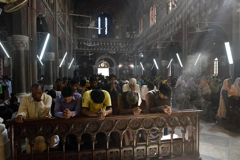 Pakistani Christians pray at the Sacred Heart Cathedral in Lahore on March 22, 2015